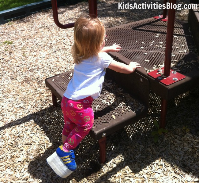 special needs girl climbing playground