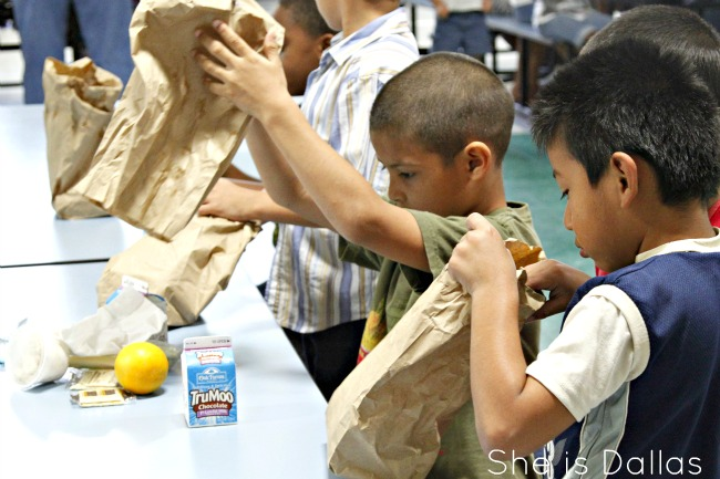 Dallas boys opening sack lunches