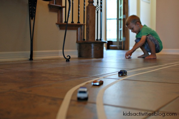 toy cars on masking tape track