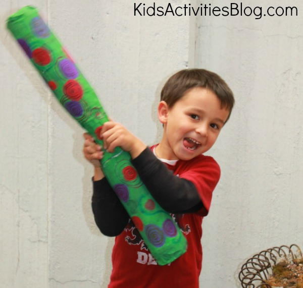 boy with rain stick