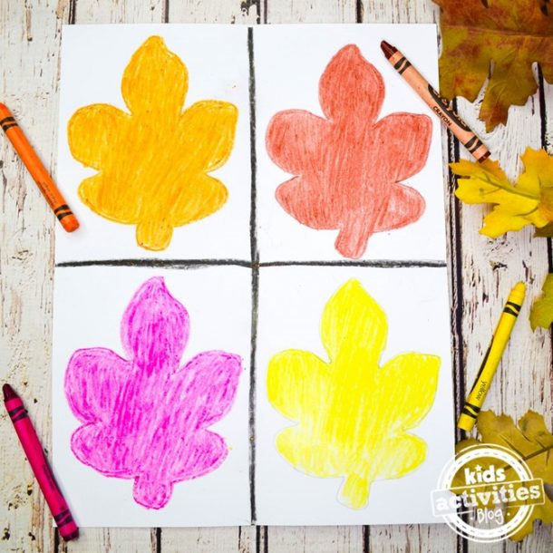 All four leaves are colored in, in this warhol inspire fall leaf project, orange, red, purple, and yellow.