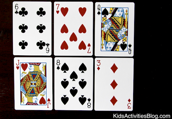 A deck of cards helps kids answer the question of what is symmetry.  Cool math activities!