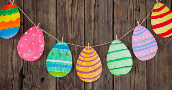 paper Easter egg garland hanging on a wall with colorful paper Easter eggs