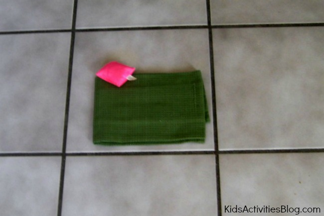 This bean bag toss can help with preposition practice {simple games}