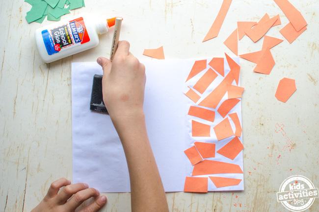 kids irish flag craft step 4 - use a brush to smooth the glue