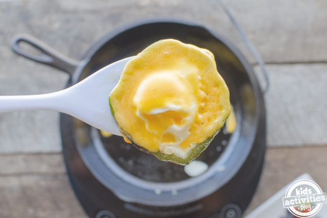 st patricks day breakfast food idea shamrock eggs recipe - last step removing cooked egg from the pan