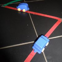 Tape track and cars by Learning to Play and Playing to Learn