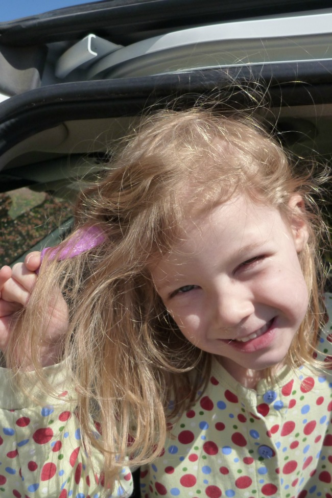 How to get gum out of kids hair - little girl with strawberry blond hair with a large wad of pink bubble gum in her long hair
