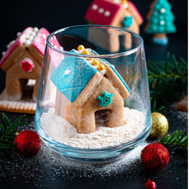 Tiny gingerbread house in a glass