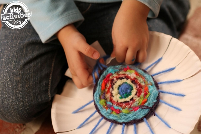 Great way to practice fine motor skills with your preschool aged kids - weave coasters