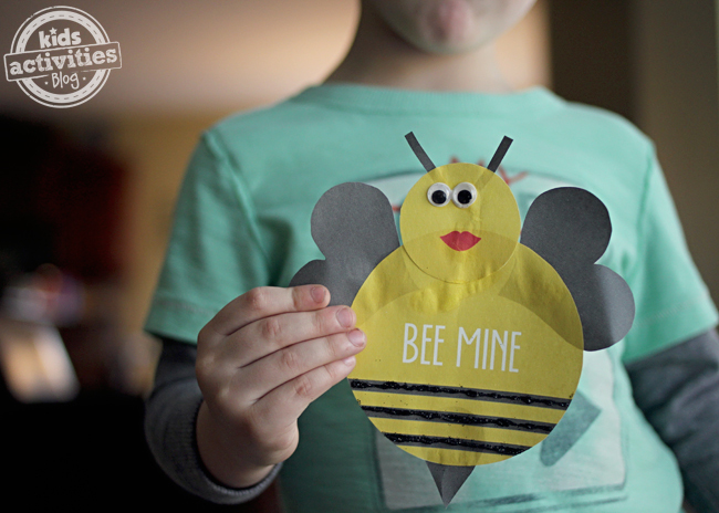 "Free Printable ""Bee Mine"" Valentine Craft with black glitter."
