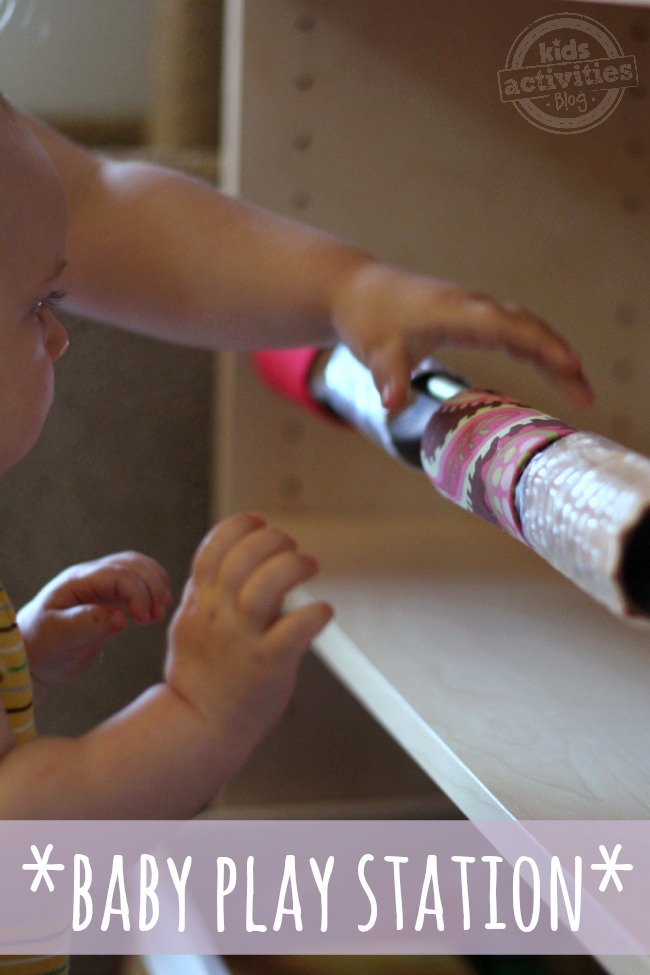 Make a Baby Play Station - Kids Activities Blog - baby shown rolling the craft rolls o a rod