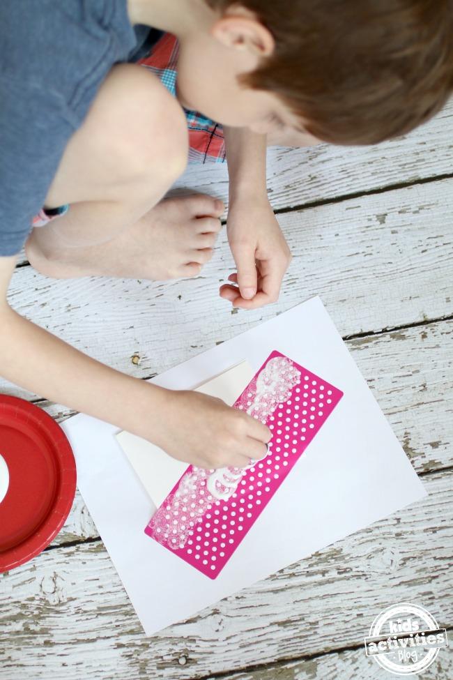 blotting mod podge on stencil - Kids Activities Blog