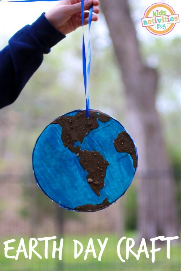 Earth Day Craft for Kids made of recycled berry boxes, paint, and dirt to look like the world.