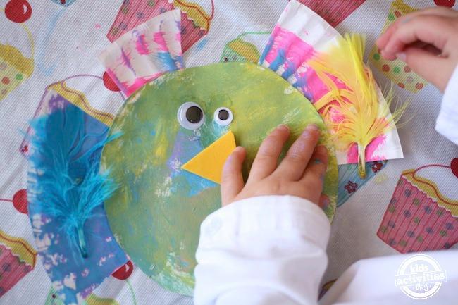 Assembling a paper plate bird