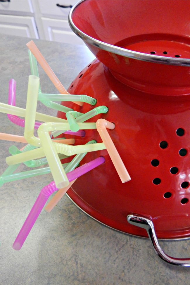 Easy Fine Motor Skills Practice With A Colander And Straws
