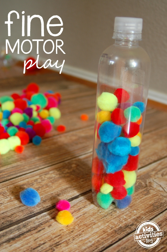 fine motor play with a pompom bottle