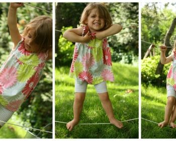 2 year old playing on backyard tight-rope