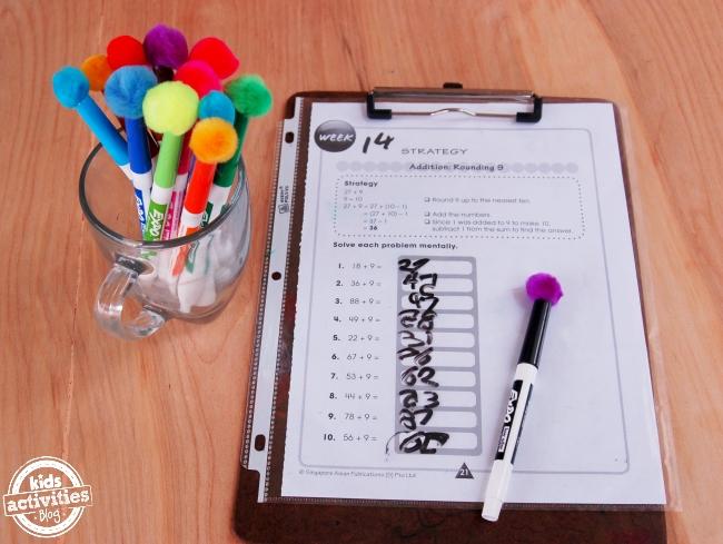 dry erase marker lids with pom-pom erasers