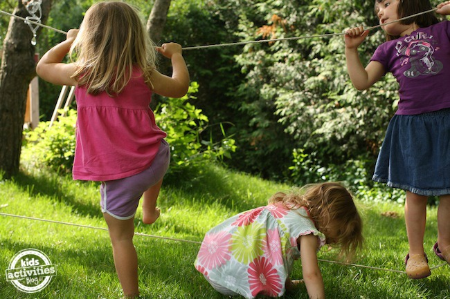 kids climbing on backyard tight-rope