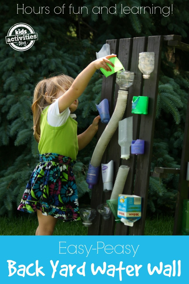 Build a backyard water wall for hours of fun and learning - Kids Activities Blog - child pouring water into a container at the top of the homemade water wall