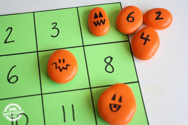 homemade math game with pumpkin rocks