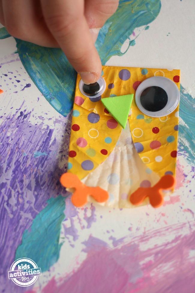 Adding eyes and beak to cupcake liner owl