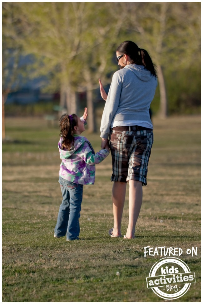 Catchy mom phrases that really work - Kids Activities Blog - mom and daughter walking outside chatting