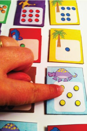 Dinosaur Puzzle Hunt is a fun game to practice counting and addition