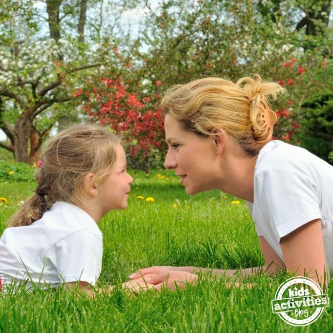mom phrases parenting - daughter and mother looking at each other smiling