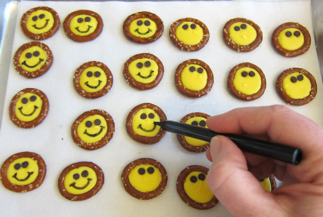 add smiles to smiley face pretzels