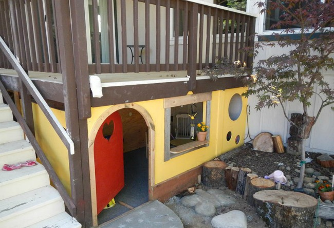 outdoor playhouse under stairs