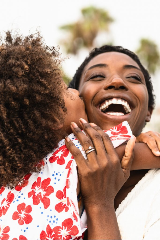 20 Catchy Mom Phrases that Actually Work article on Kids Activities Blog - mom and daughter hugging
