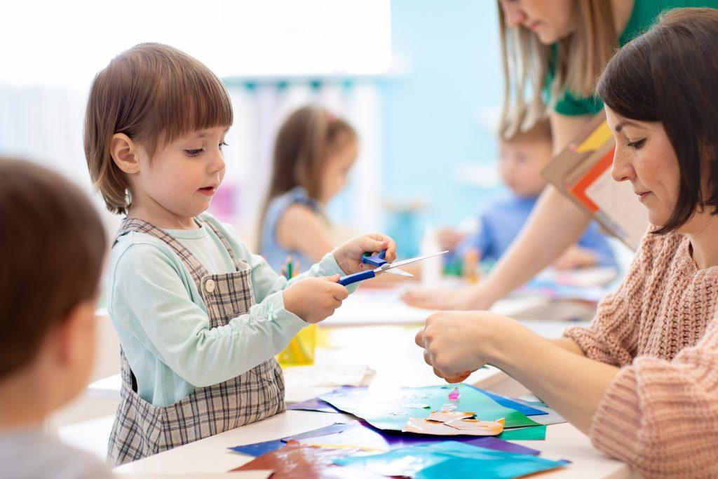 Kids making jumbo coloring poster