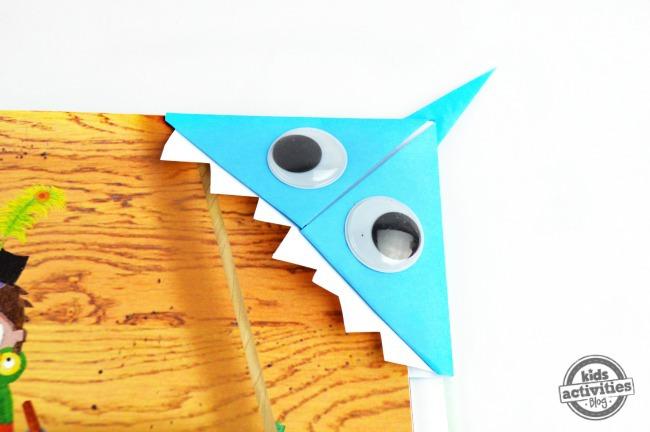 origami shark bookmark on book