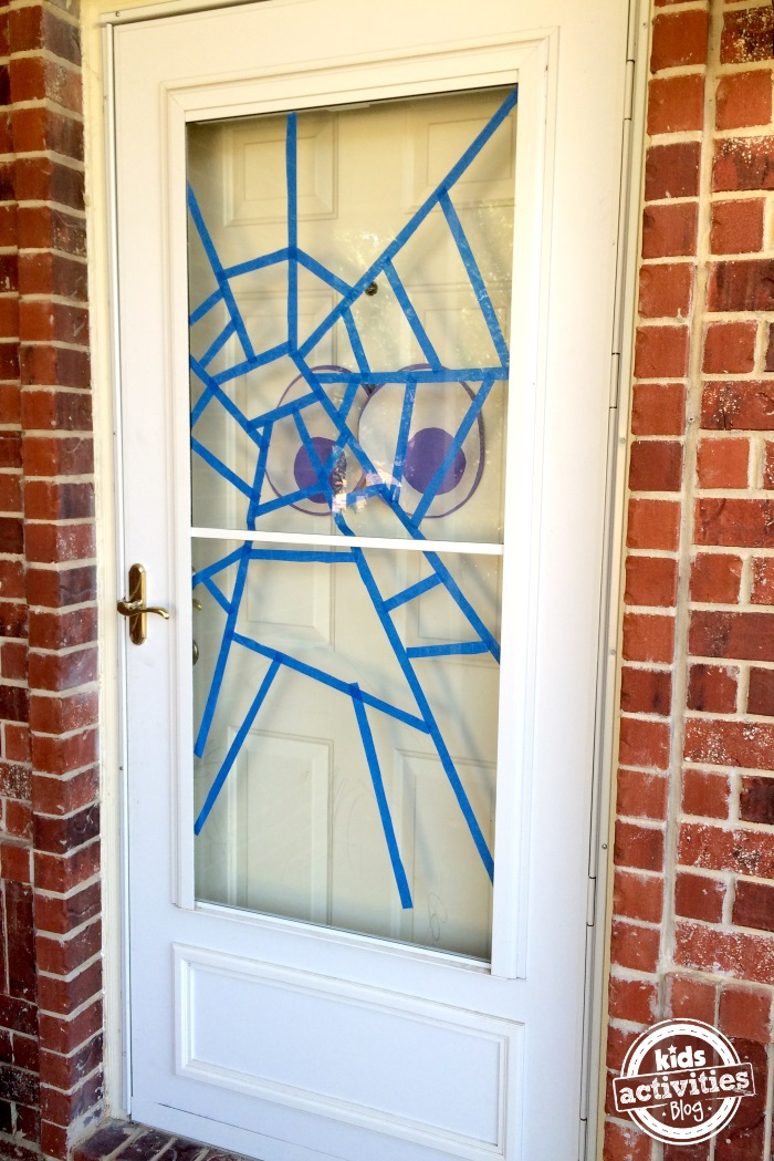halloween door with spider web