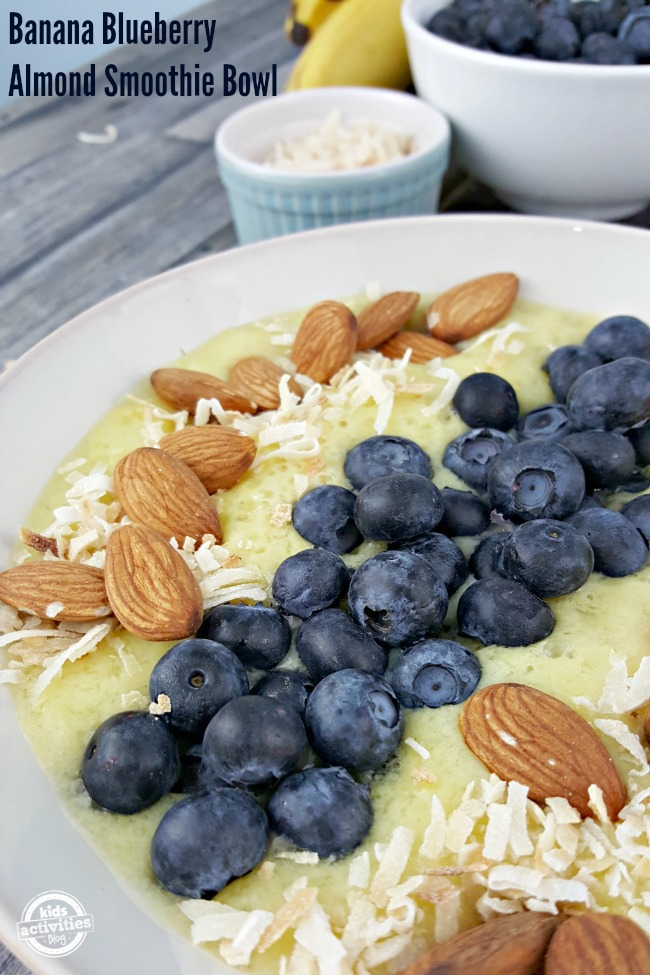 Imagine kicking your sweet tooth craving by spooning up some of this Banana Blueberry Almond Smoothie Bowl