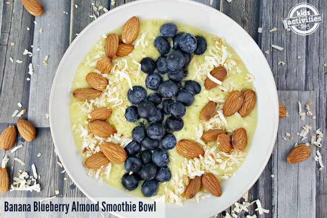 Top this Banana Blueberry Almond Smoothie Bowl with toasted coconut for extra flavor and crunch.