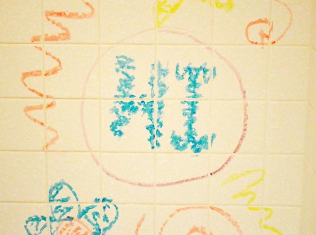 bath crayons on wall