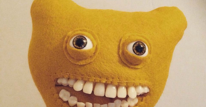 These smiley plush dolls are the