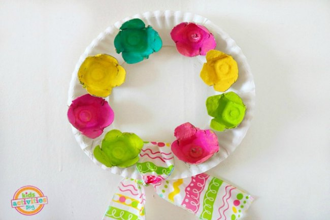 Egg Carton Flower Wreath craft finished and hanging on the wall