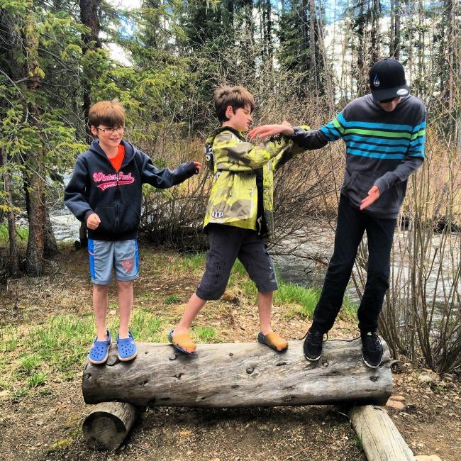 Road Trip Tips Boys on Log
