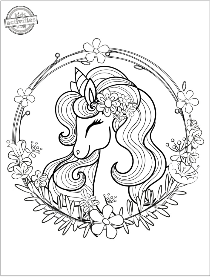 Unicorn Head in a Flower Wreath Coloring Page - Kids Activities Blog - printable free coloring page pdf shown with floral wreath surrounding unicorn head with flowing unicorn hair