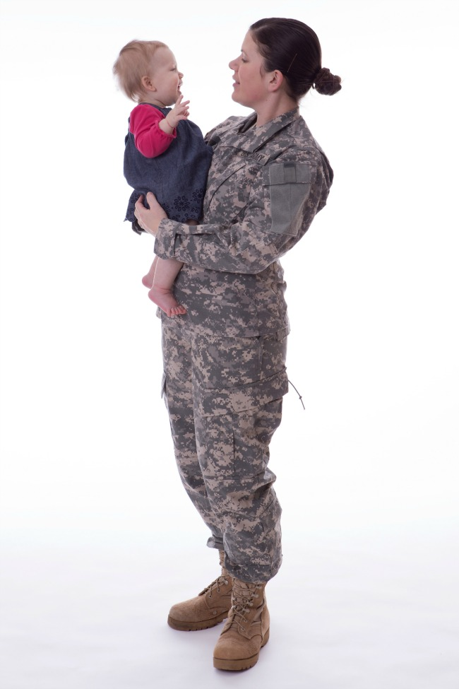 Us military mother holding her child on white background