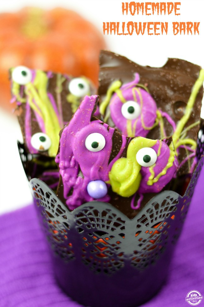 homemade halloween candy bark with yellow and purple candy melts milk chocolate and sugar eyes