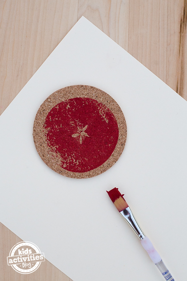 "Making Apple Print Coasters is a fun craft to do with kids after visiting an apple farm. Kids will enjoy seeing the ""star"" on the inside of the apple, then stamping it onto a cork coaster to use as an ornament, gift, or coaster for home. This craft requires basic supplies and can be done at home, school, or daycare."