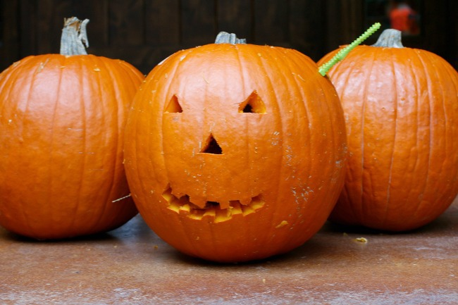 pumpkin with a knife in head
