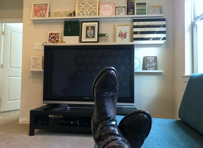 boots on the sofa