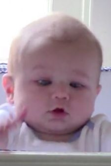 Adorable Baby Takes Slow-Mo Tumble, Laughs About It