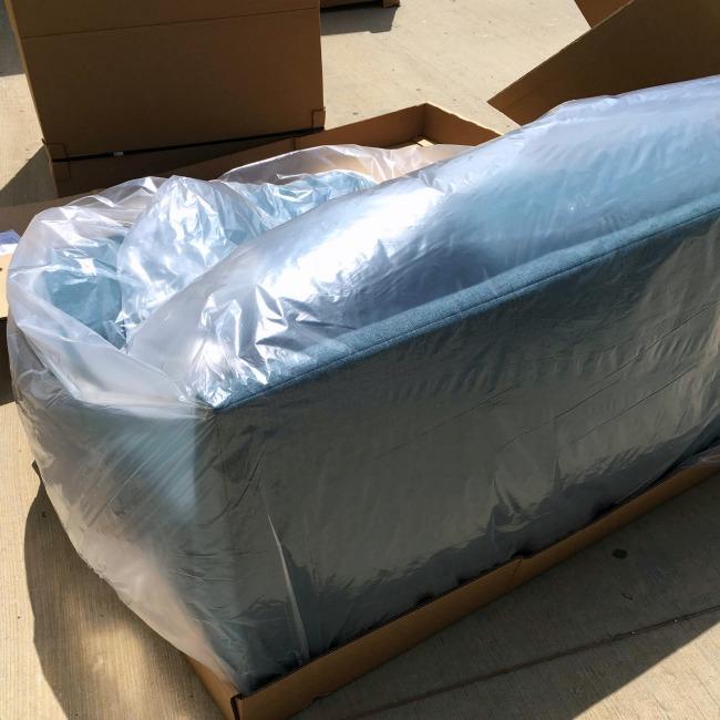 unpacking Joybird sectional sofa